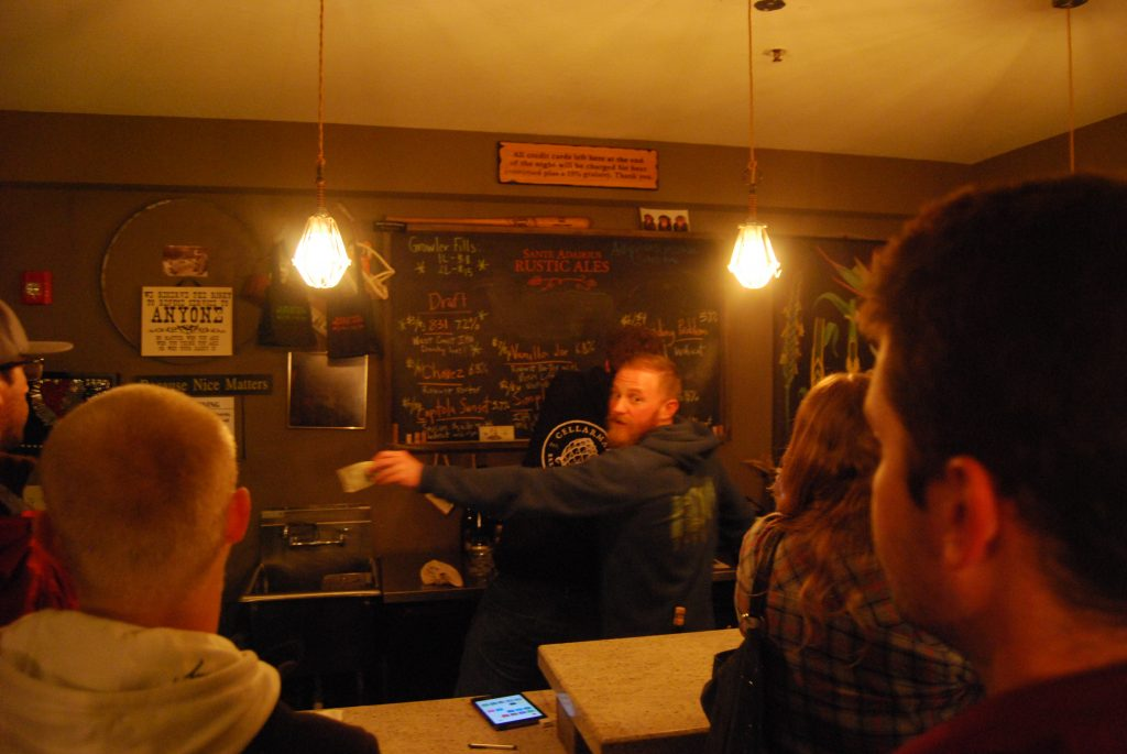 The tap list, with Jay hard at work in the foreground.