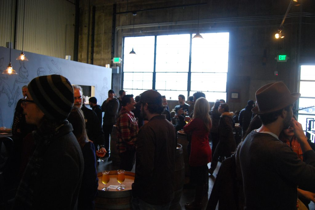 People enjoying the tap room and release.
