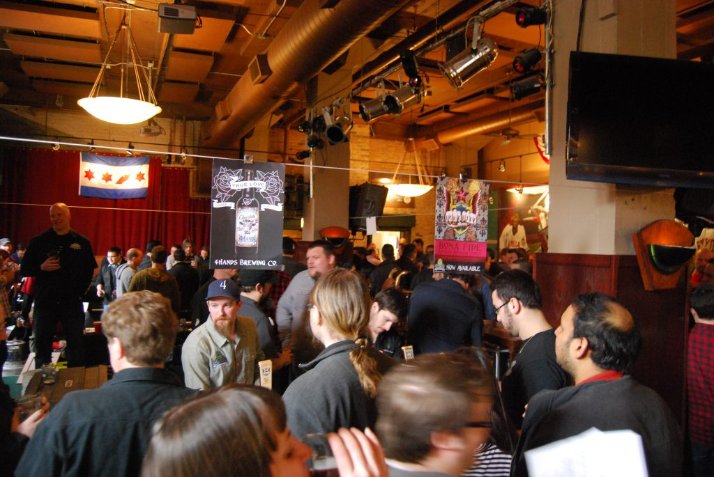 The main room, with 4 Hands brewery pouring in the foreground.