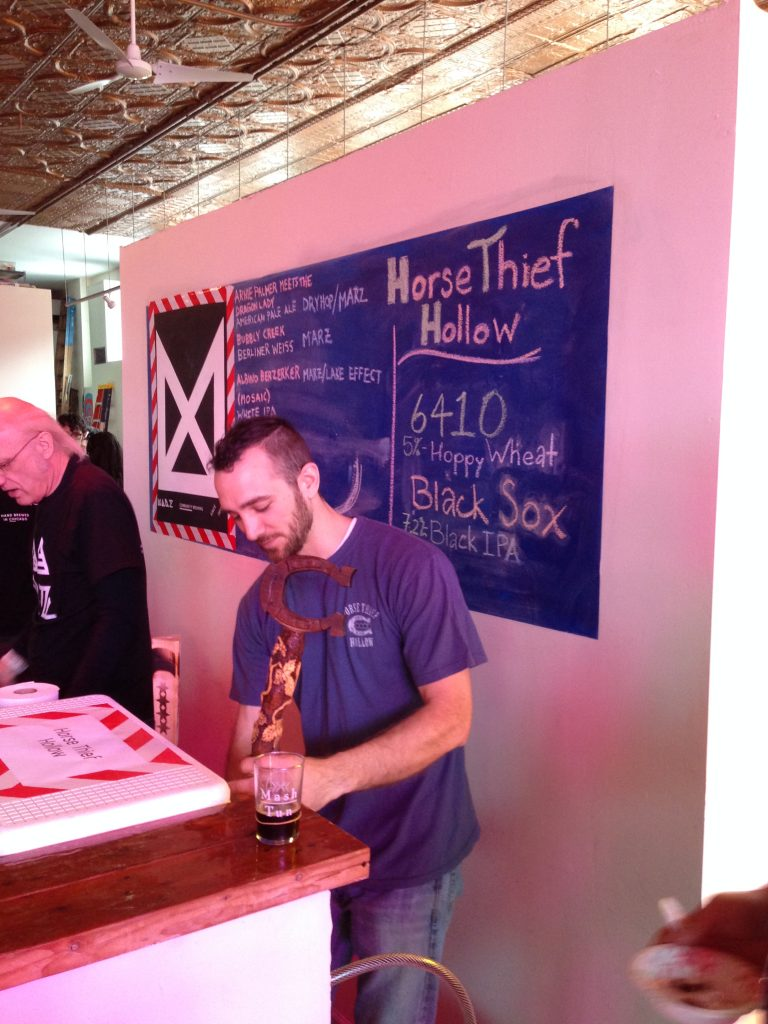 Andy pouring Horse Thief Hollow's Black Sox IPA.