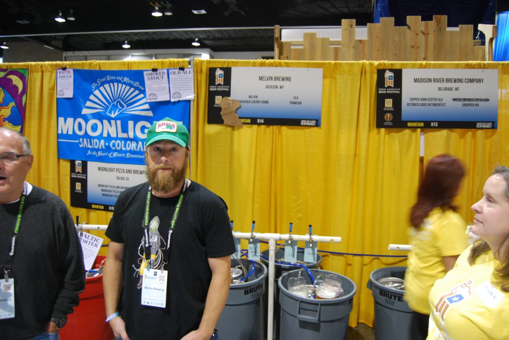 Jeremy Tofte of Melvin Brewing, with Melvin's tap list behind him.