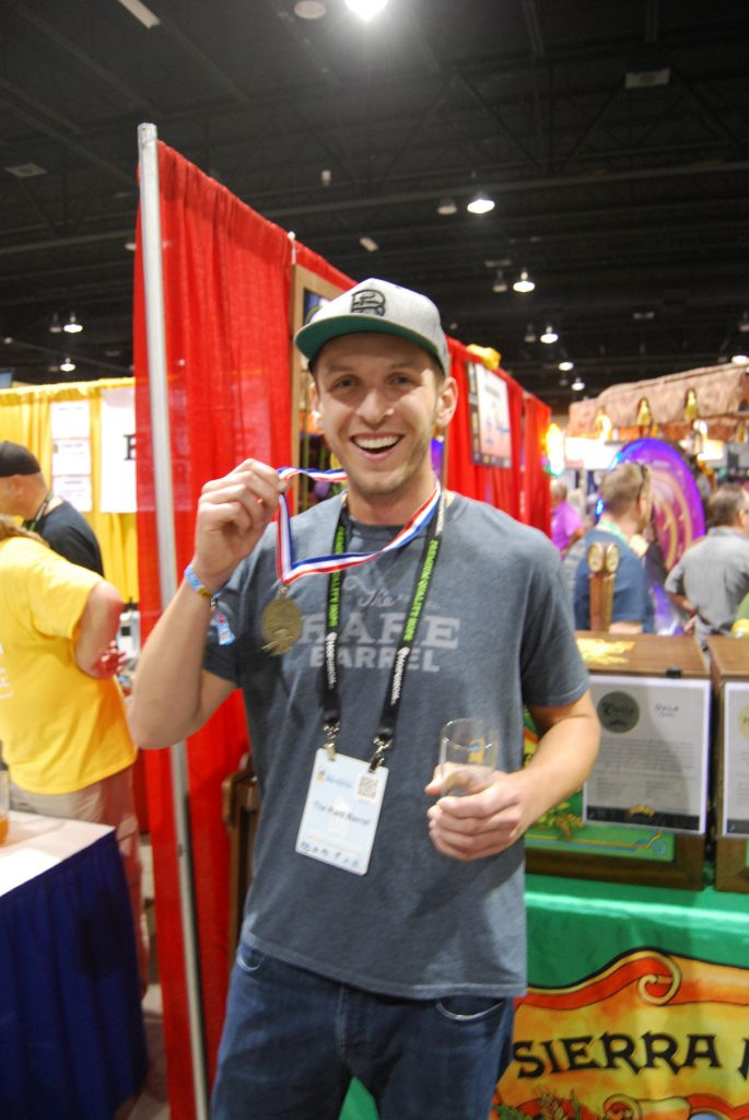 Alex from The Rare Barrel with their gold medal for Cosmic Dust.