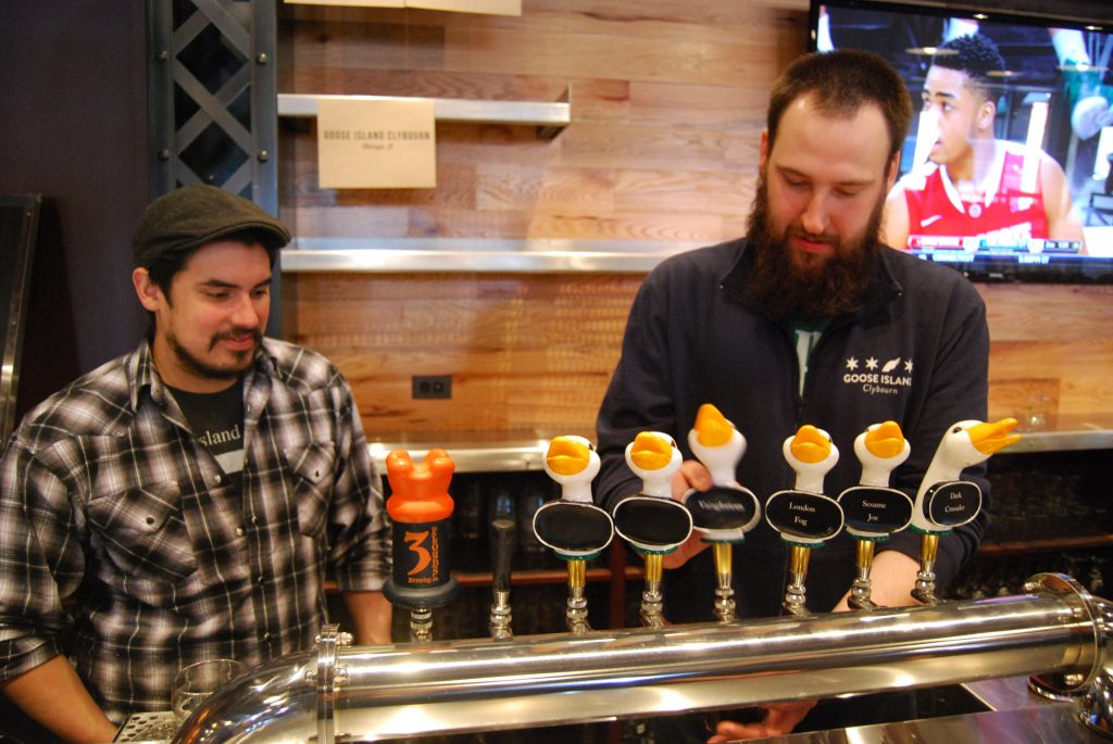 Jacob Sembrano (left) and Jon Naghski (right) pour Goose Island Clybourn's offerings.