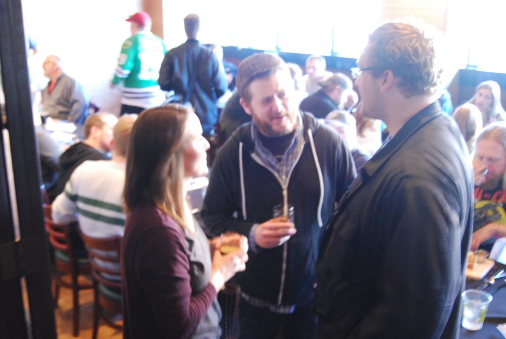 Ryan (center) and Craig (right) talk to Claudia Jendron (left), head brewer of Temperance.